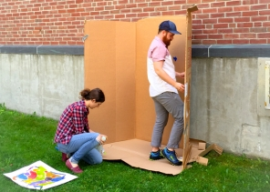 MAT2 grad students, Anastasia and Kris, setting up the spray booth.