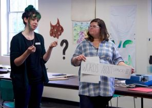 MAT2 grad students, Kiley and Cythia explaining student-centered stations