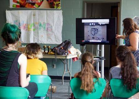 MAT2 grad student, Cynthia introducing next activity